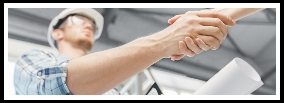 Contractor and client shaking hands